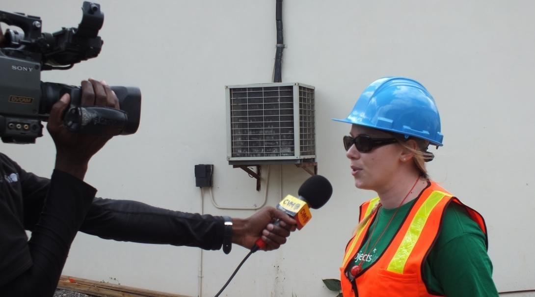 Female International Development intern is interviewed by a local TV station during her Work Experience in Distaster Management in Jamaica.